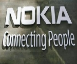 The corporate logo hangs on a wall at Nokia world headquarters in Helsinki