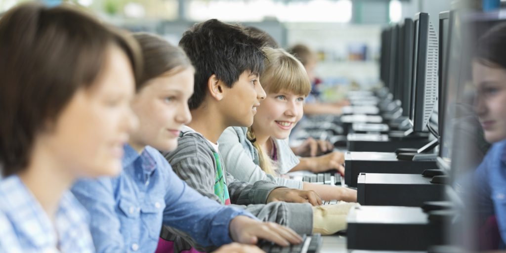 Students using computers in classroom